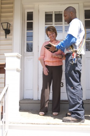 Technician explains service ticket using tablet