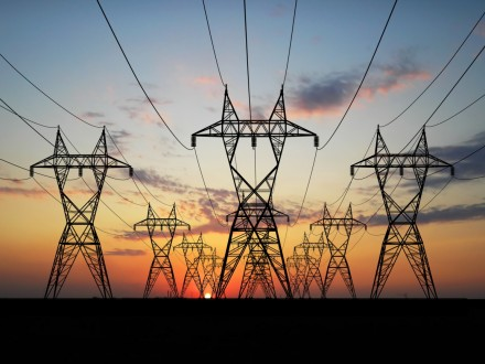 3d_electric_powerlines_over_sunrise